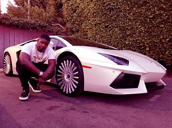 Image of Blac Youngsta with his white Lamborghini car