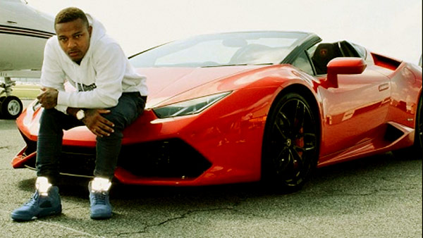 Image of Rapper, Bow Wow with his Ferrari car
