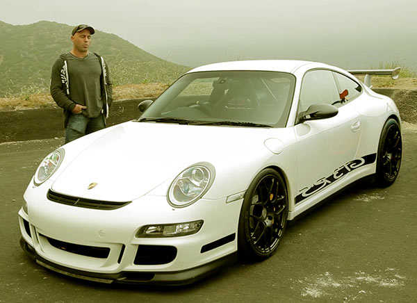 Image of Comedian, Joe Rogan with his car Porsche 911 GT3 RS