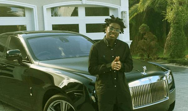 Image of Rapper, Kodak Black with his car Rolls Royce Ghost