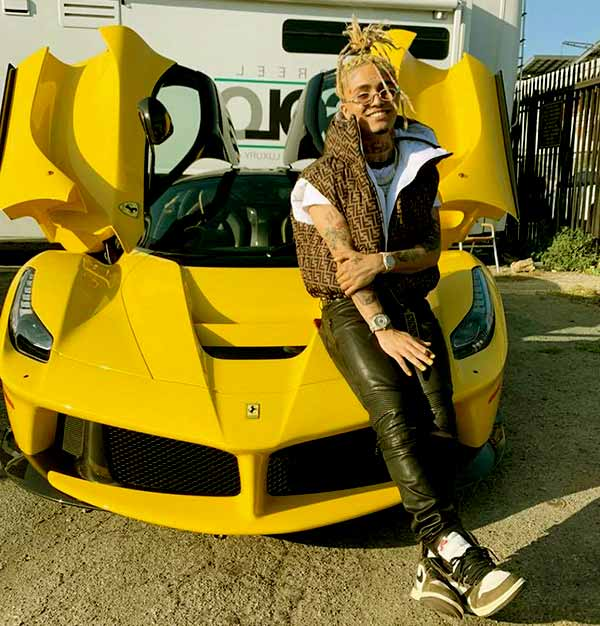Image of Rapper, Lil Pump with his Yellow Porsche car