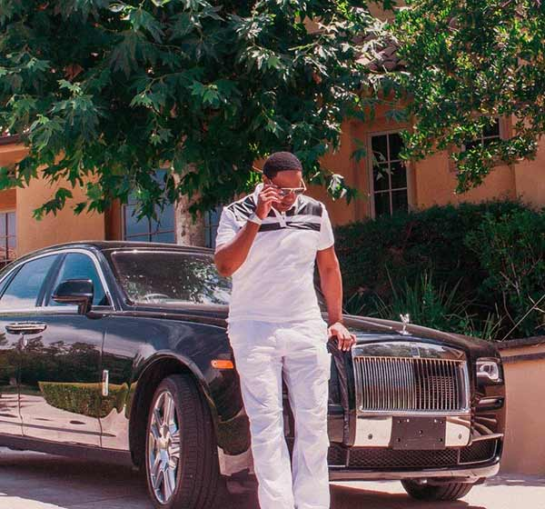 Image of Rapper, Master P with his car