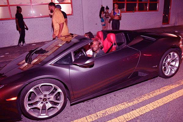 Image of Young Thug with his car