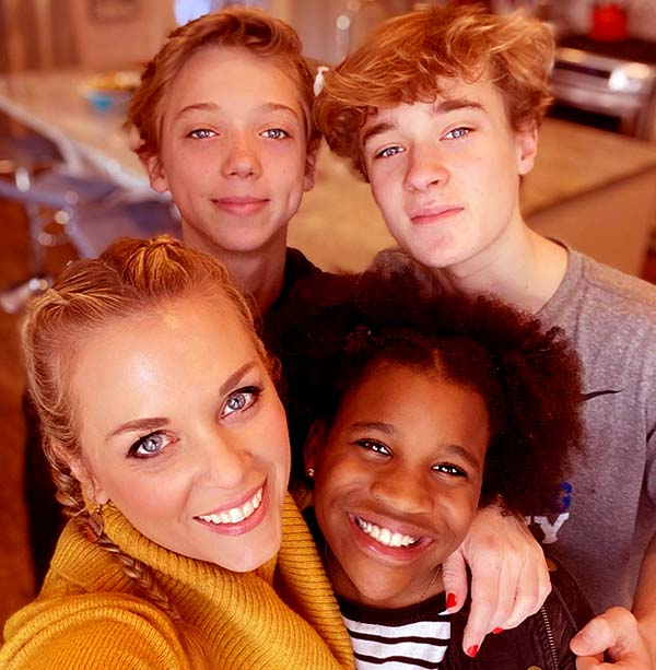 Image of Caption: Kortney Wilson with her three kids Jett, Sully and Lennox