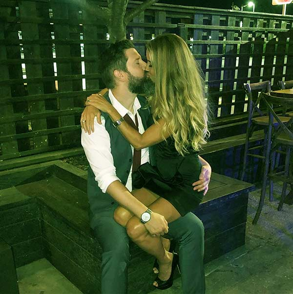 Image of Nicole Curtis posted a photo of  kissing another man on Instagram